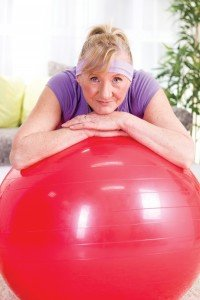 Weight Loss Senior woman after exercises relaxes