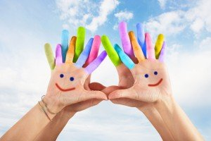 Children's Health Painted hands with smile