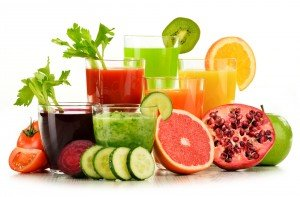 Detoxification Glasses with fresh organic vegetable and fruit juices on white