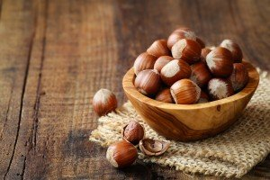 Food Intolerance Hazelnuts in a wooden bowl on rustic background