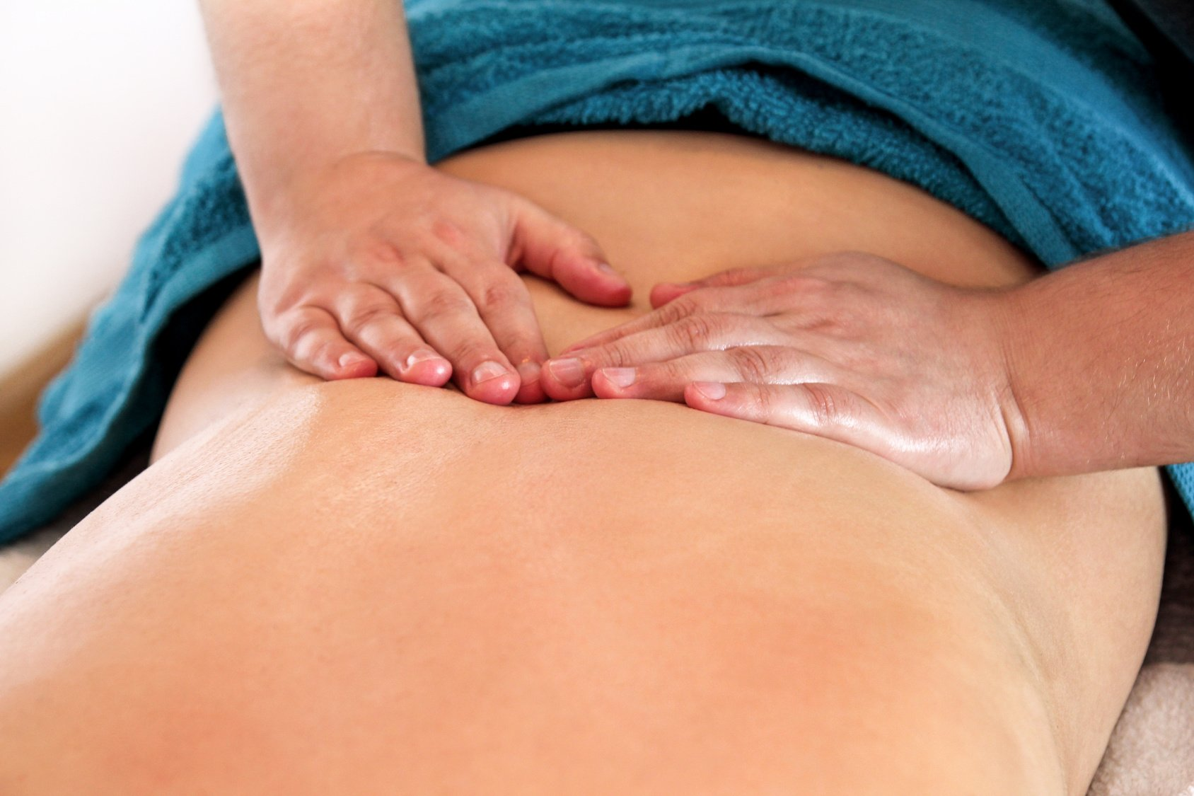 Massage relax studio. Massage back. Young woman receiving back massage at spa. Masseuse hands massaging female back.