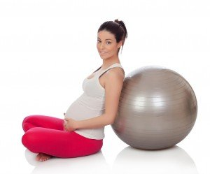 Natural Fertility Beautiful pregnant woman doing pilates