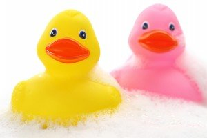 Natural Fertility Yellow and pink rubber ducks in bath foam