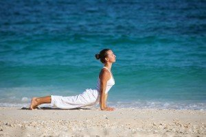Detoxification Caucasian woman practicing yoga at seashore