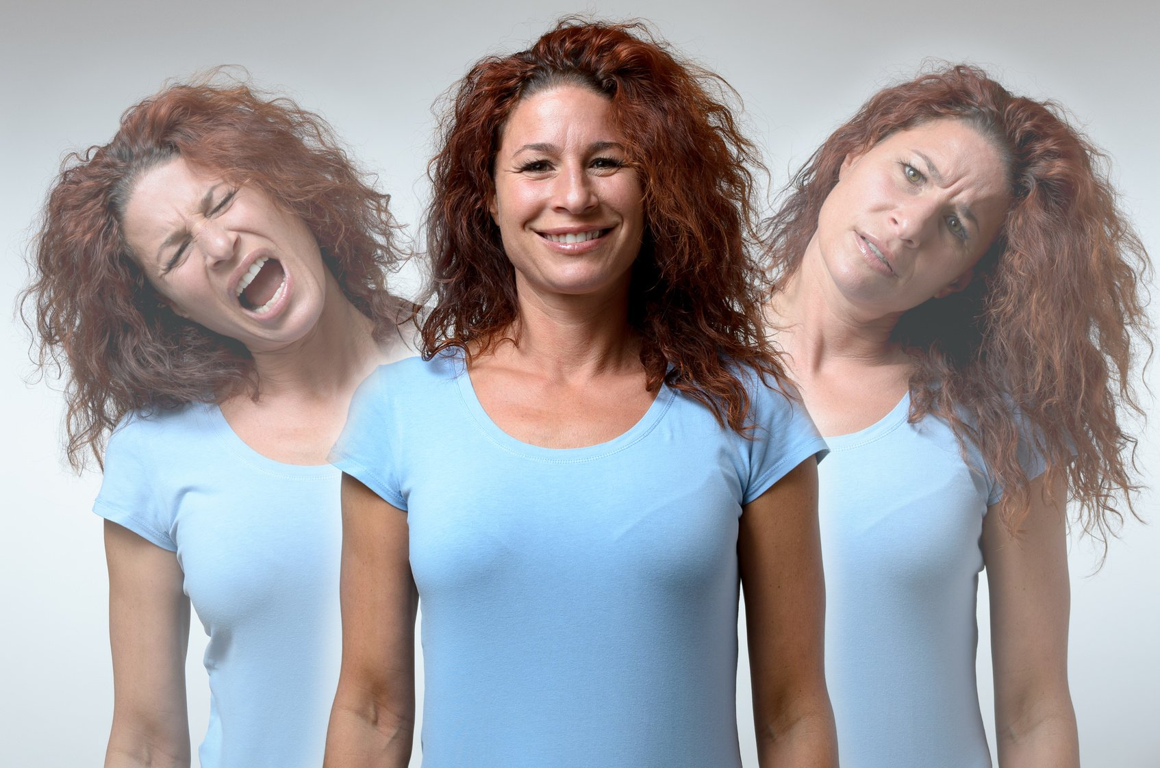 psychology Front view on three versions of woman changing from moods of anger, joy and confusion
